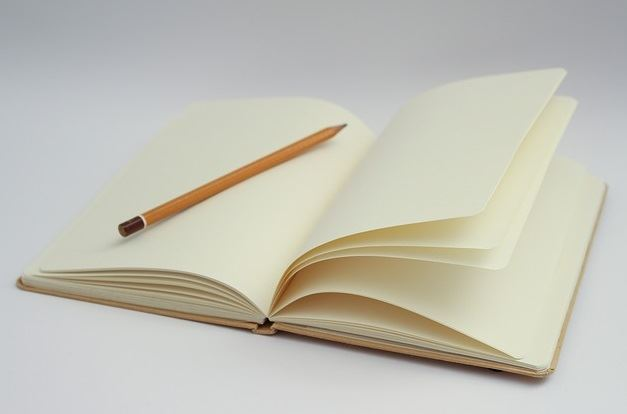 blank journal and a pencil